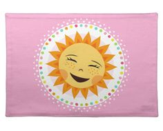 Cute placemat for kids featuring a happy sun with a colorful polka dot border on a pink background. Adorable design for girls