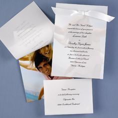 Full Color Photo Invitation with Translucent Layer  Your wording is printed on a translucent top layer, which is secured by satin ribbon to the bottom layer featuring your photo. Your choice of black, lavender, moss, pink, red, silver or white ribbon. Customer assembly required.