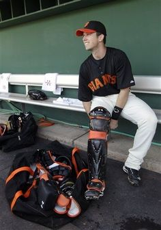 San Francisco Giants catcher Buster Posey gears up for a spring training baseball game against the Cincinnati Reds, Friday, March 9, 2012, in Scottsdale, Ariz. (AP Photo/Marcio Jose Sanchez)
