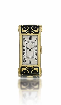AN ART DECO ENAMEL LAPEL WATCH, BY CARTIER - The cream rectangular dial with black painted Roman numerals and blued steel hands, to the plain bezel and Persian design black enamel decorated case, mechanical movement, circa 1935