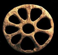 Mammoth ivory wheel from Sungir, Upper Paleolithic. I think it could be jewelry at some point...