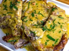 Slow Cooker Pork Chops with Golden Ranch Gravy - (The meat falls off the bone - try this for sure).