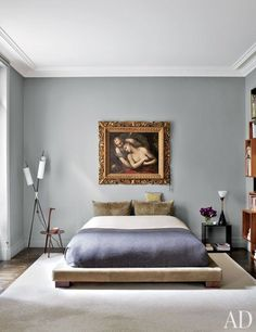 While fashion designer Stefano Pilati's Paris duplex is bursting with color and a treasure trove of antiques and artifacts, his master bedroom is artfully spare. The soft-gray walls highlight the Italian painting given to Pilati by his mother. Grey Room, Gray Bedroom, Master Bedroom, Room Paint Colors, Paint Colors For Living Room, Architectural Digest, Modern Floor Lamps, Chair And Ottoman, Grey Walls