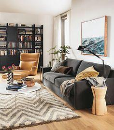 Casual modern living room / herringbone rug / rustic wood stump side table / neutral colors
