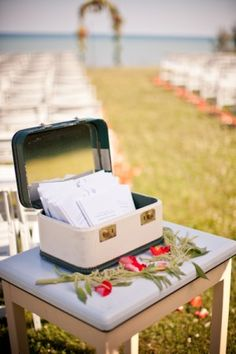 Find a vintage box for a few dollars at a thrift store and use it to hold wedding programs.