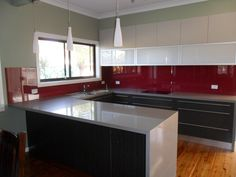 Polyurethane kitchen, stone bench top and glass splash back -- colour