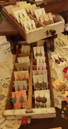 Awesome earring display idea - shallow drawers with separators, and earring pairs on little cards (wallpaper scraps) Vintage compartment drawers that I use as earring displays. Stall Display, Craft Booth Displays, Craft Booths, Retail Displays, Shop Displays, Window Displays, Display Boxes, Clothing Booth Display, Storage Boxes