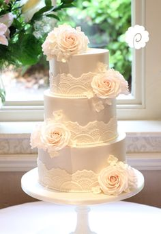 Delicate champagne lustre and blush vintage lace wedding cake