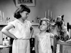 Shirley Temple in Bright Eyes (1934) with often mischievous co-star, Jane Withers. Jane is still alive today at age 87.