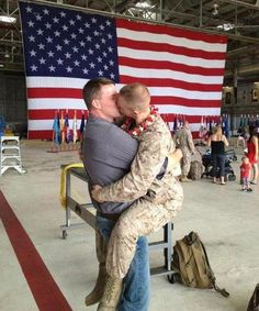 Homecoming + 'war is done' images are powerful.   Sgt. Brandon Morgan and his partner Dalan Wells sharing a welcome home kiss in Hawaii.