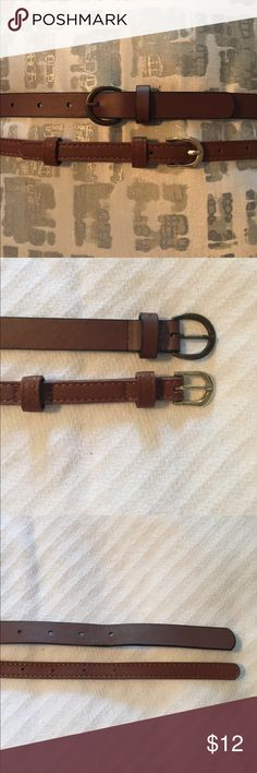 """Brown belt duo! These two skinny belts are camel brown. One is 3/4"""" thick and adjusts from 28""""-32"""". The skinnier one is 1/2"""" thick and adjusts from 30.5""""-35"""". Both are just like new!! Accessories Belts"""