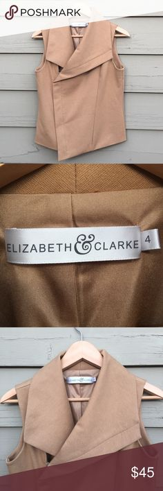 Elizabeth & Clarke Asymmetrical Cutoff Vest Elizabeth & Clarke Asymmetrical Camel-Colored Side-Zip Cutoff Blazer/Moto Vest. Came in a subscription box and it's just not my style. Never worn or washed. Elizabeth & Clarke Jackets & Coats Vests