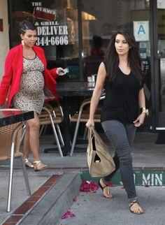 Kourtney in a Kate Frances blazer, Kardashian Kollection dress, Pucci sandals and Nissa earrings.
