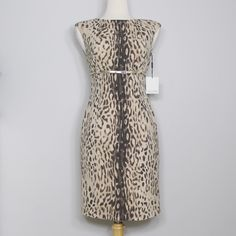 Calvin Klein Leopard Print Dress This sand colored dress is great for work! High waist with a gold belt (included) that adds a polishing finish to the look. Sheath-dress style / sleeveless / poly rayon spandex / no holes, stains or imperfections / comes from a smoke free environment  Bundles welcome Offers welcome through offer button. ❌NO trades, please. ⚡️Same/Next day shipping Calvin Klein Dresses
