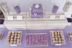 I love this set up.  You can do it instead of a cake table and just do desserts and treats or we could do this as a favors table. :)