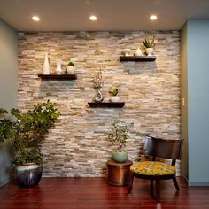 Create a Faux Stone Accent Wall - Cover a wall with stone veneer and transform a room! You can transform any room with a stunning stone accent wall like this. Faux Stone Walls, Stone Accent Walls, Faux Brick, Faux Stone Sheets, Kitchen Accent Walls, Stone Wall Tiles, Kitchen Stone Wall, Living Room Wallpaper Accent Wall, Faux Stone Wall Panels