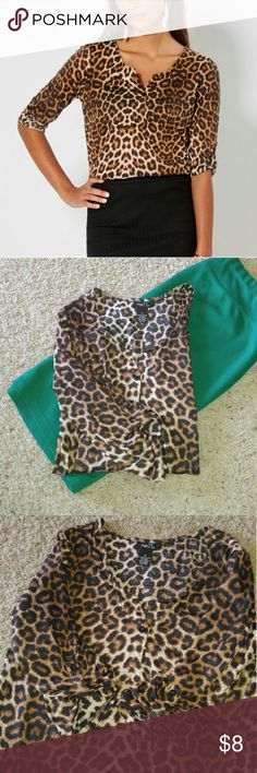 Rue 21 Leopard Print Henley Top Super comfy ~ Can be Dressy or Casual ~ Single button on front ~ Buttons on sleeves to hold up rolled sleeves ~ Fabric has like a T-Shirt feel so it's very comfortable 100% Polyester Rue 21 Tops Button Down Shirts