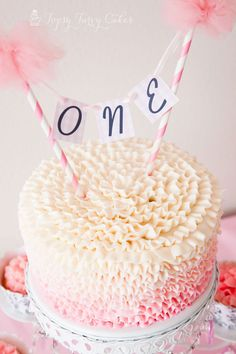 Minnie banner on ruffled ombre cake