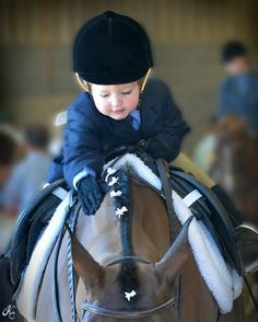 Tomorrows Horseman Today…  Micah Fraser at age two…gives his horse a little calming love…before his lead line class…in Scottsdale, AZ…have you hugged your horse today..?  Photo by Kelly Campbell, Arare Photography LLC…
