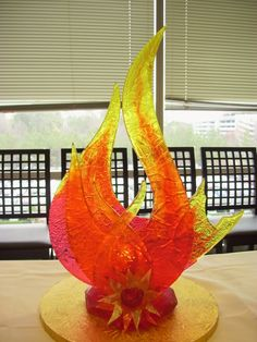 "Sugar Sculpture Photo: The ""Fire"" piece for my Four Elements themed showcase. It was constructed using mold cast sugar, hand cast sugar, pull. Blown Sugar Art, Pulled Sugar Art, Sugar Glass, Chocolate Showpiece, Chocolate Work, Baking School, Food Sculpture, Chocolate Sculptures, Edible Creations"