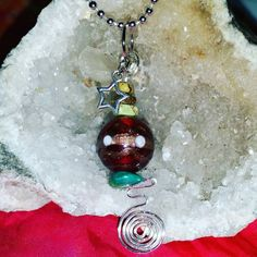 Check out this item in my Etsy shop https://www.etsy.com/listing/251279346/beaded-spiral-pendant-necklace