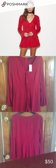 NWT Kendall & Kylie red romper NWT Kendall & Kylie deep-v long sleeve romper size Medium originally $49.95. Includes a removable tie fabric near the top of the v-neck. Note I draw through the barcode so it can't be returned. Kendall & Kylie Pants Jumpsuits & Rompers