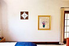 Antique artwork in eclectic bedroom