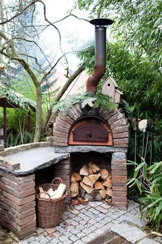 Have a small patio area with a outside pizza oven and fitted bbq #gardendesign