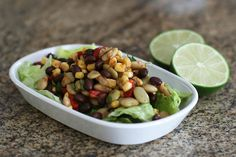 Black bean salad recipe with a tangy lime and apricot preserve dressing. This corn and black bean salad is dressed with an easy, tangy dressing.
