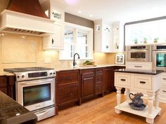 Black Appliances Wood Floor Green Kitchen Traditional