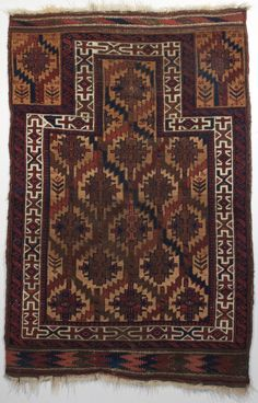 Persian Baluch prayer rug with Asmalyk (Turkmen) design elements. Woven in Northeast Persia, circa 3rd quarter of the 19th century.