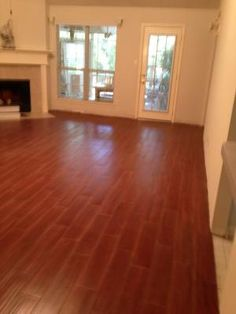 Ceramic tile that looks like wood. Most durable surface for dog owners that like hardwood floors.