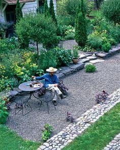 Gravel patio with stone border
