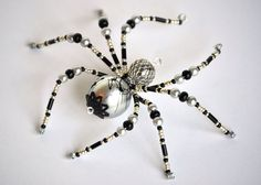 Jarl  This beautiful spider is hand-beaded with gray glass pearl beads, and…