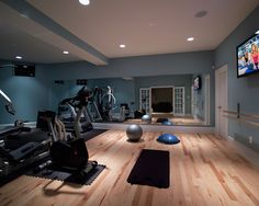 Wood flooring in the gym. Wall length mirror. Love the cornflower blue walls. ask about wiring for television.