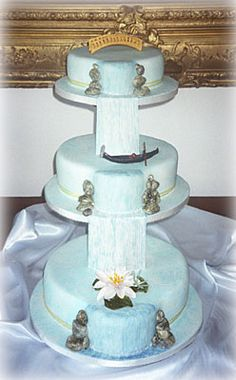 Bespoke cake designs can be created specially for you, such as this striking waterfall design, which features a bride, gondola and waterlilies. Waterfall Cake, Waterfall Wedding, Waterfall Design, Camp Wedding, Wedding Events, Dream Wedding, Wedding Stuff, Weddings, Themed Wedding Cakes