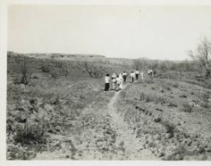 "Unidentified photographer, ""Georgia O'Keeffe and Friends Hiking in Palo Duro Canyon, Texas,"" c. 1912-1913. Photographic print, 3 1/2 x 5 1/2 in. Georgia O'Keeffe Museum. Gift of The Georgia O'Keeffe Foundation. 2006-06-0743. Copyright Georgia O'Keeffe Museum."