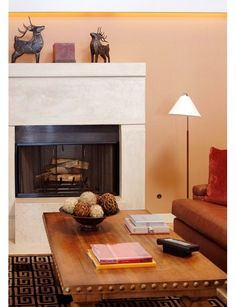 A fire place is a must. It is an essential household luxury accent for me. I expect to have at least one in either my bedroom or living room. Of coarse having one in both areas is great but if I have to go with one, which I likely will starting off, I will NEED a fireplace in my living room.  As for the coffee table, what would a living room be without one?  -Another must have.