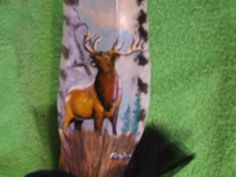 elk painted on a feather