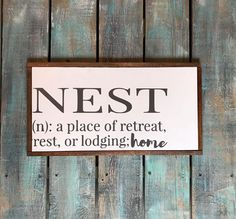 Hand painted wood sign, Nest a place of retreat rest or lodging; home This is a ready to ship item (1 available) *appx. 20 wide x 10 high *Handcrafted from a painted wood backing *Framed with stained wood trim *All lettering is hand painted, no vinyl on signs. If you would like a specific paint color for your lettering, please specify in your order. *It includes a hanger already installed on the back. *Top surface is sealed with a durable clear matte finish to protect from scratches, water…