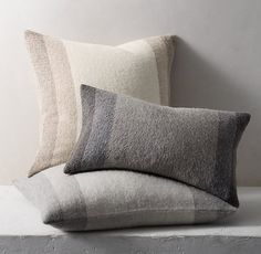 Restoration Hardware's Alpaca Wide Stripe pillows create a cozy and luxurious look in your living room.