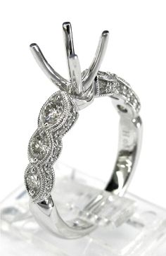 Ladies 14kt white gold semi mount. Mounted in ring are 42 brilliant round cut diamonds weighing a total of .76ct. Mounting is made to take approximately 1ct round diamond in the center.