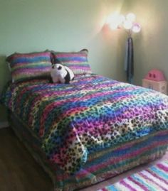 This  rainbow leopard print comforter set goes to show that animal prints don't have to come in boring neutral colors. Take a walk on the really...