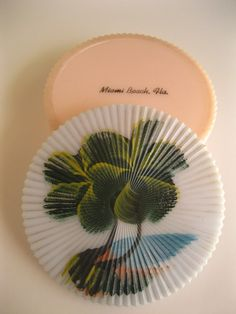 Set of Florida drink coasters in a gorgeous hard plastic box with hand-painted palm trees - souvenir of Miami Beach  https://www.etsy.com/listing/123884600/vintage-1940s-miami-beach-souvenir?ref=listing-shop-header-0