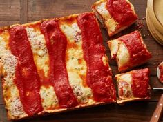 Detroit-Style Pizza - The tangy blend of cheese that crisps around the edges of the pan, the spongy dough and the sauce that is spooned on after you bake it are unmistakable signs that you've bitten into a slice of Detroit's squared-off take on the ever-popular pizza. http://www.foodnetwork.com/recipes/food-network-kitchen/detroit-style-pizza-3634995