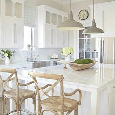 love this kitchen with the X back chairs and grey lights
