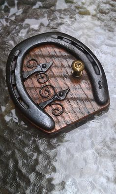 I make these doors from used horse shoes, hand forged hardware, and repurposed items. 5 inches tall and 4 inches wide. All your wee folk will love them Fairy Tree Houses, Fairy Village, Fairy Garden Houses, Gnome Garden, Fairy Gardens, Diy Fairy Door, Fairy Garden Doors, Fairy Doors On Trees, Horseshoe Crafts
