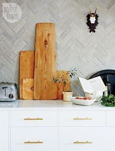 Style at Home California Cool Kitchen.Concrete Tile Backsplash Herringbone Pattern and Wood Cutting Boards Kitchen Backsplash, Kitchen Countertops, Stone Backsplash, Kitchen Fixtures, Kitchen Splashback Ideas, Kitchen Soffit, Backsplash Cheap, Blue Backsplash, Beadboard Backsplash