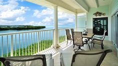 """Your spacious oceanfront balcony will be a front row seat for a panorama of azure blue ocean and sky. There are touches of tropical whimsy everywhere, like the """"Windblown Table Lamp"""" in the reading alcove, a quirky ..."""