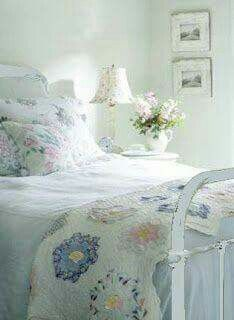 Pretty bedroom with quilt